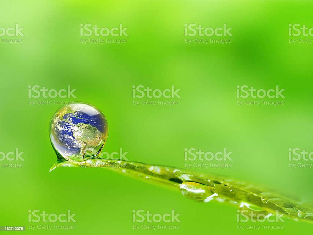 Water Drop on Leaf with the Planet Earth Reflected Inside royalty-free stock photo