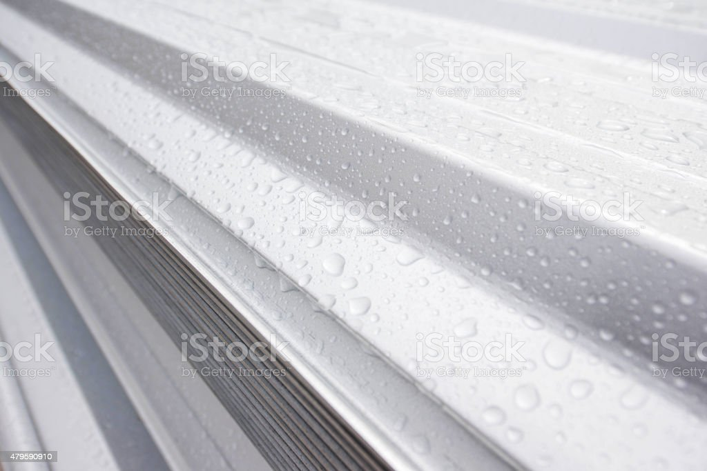 Water drop on metal sheet roof stock photo