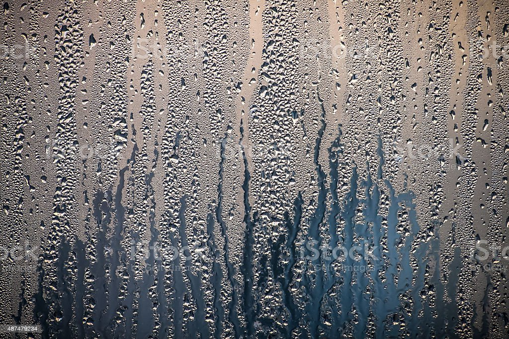 water droplets in a window stock photo