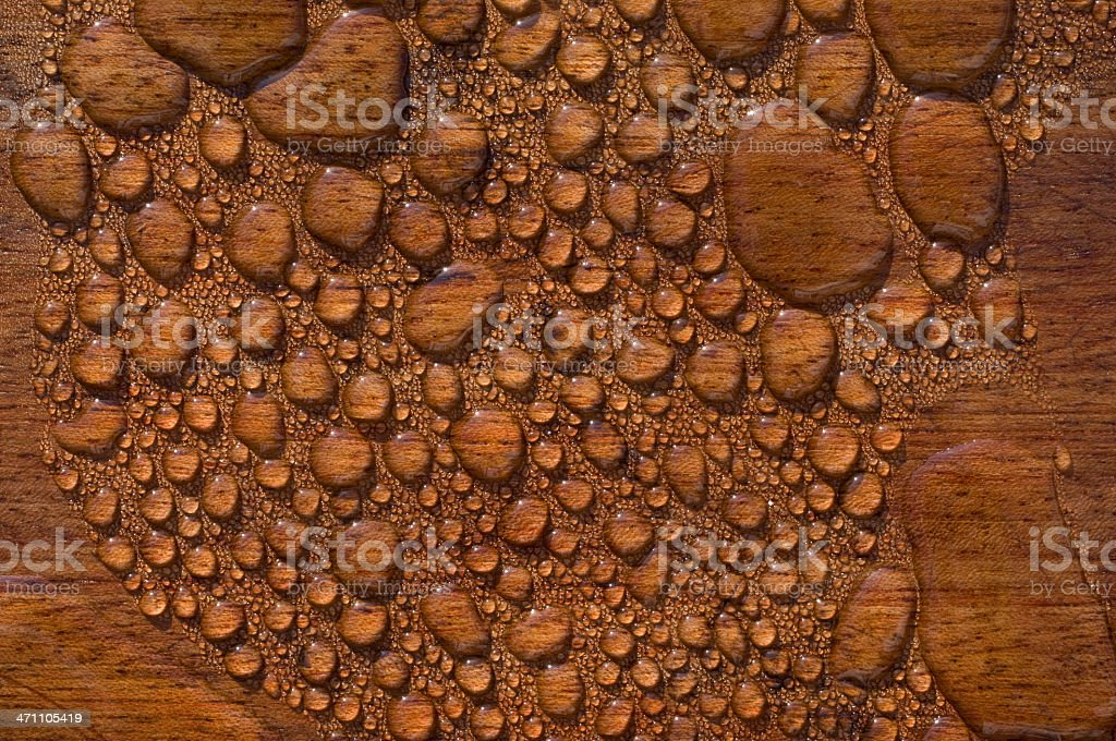 Water Droplets On Freshly Oiled  Patio Decking stock photo