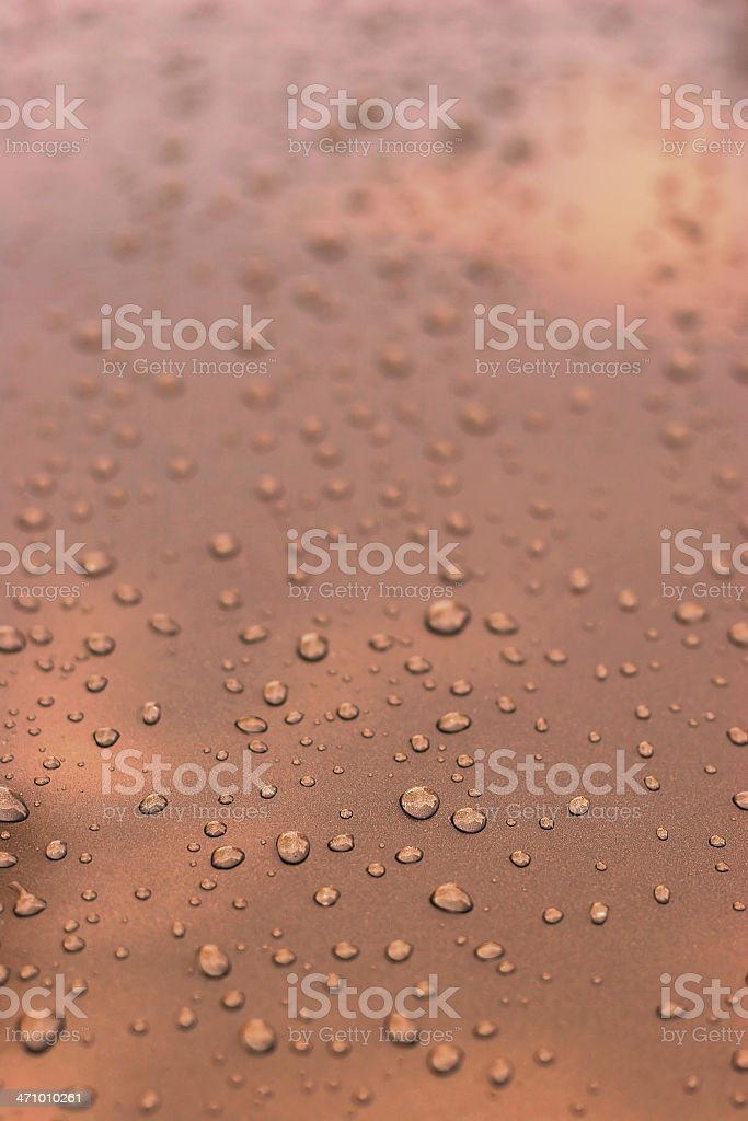 Water droplets on polished copper royalty-free stock photo