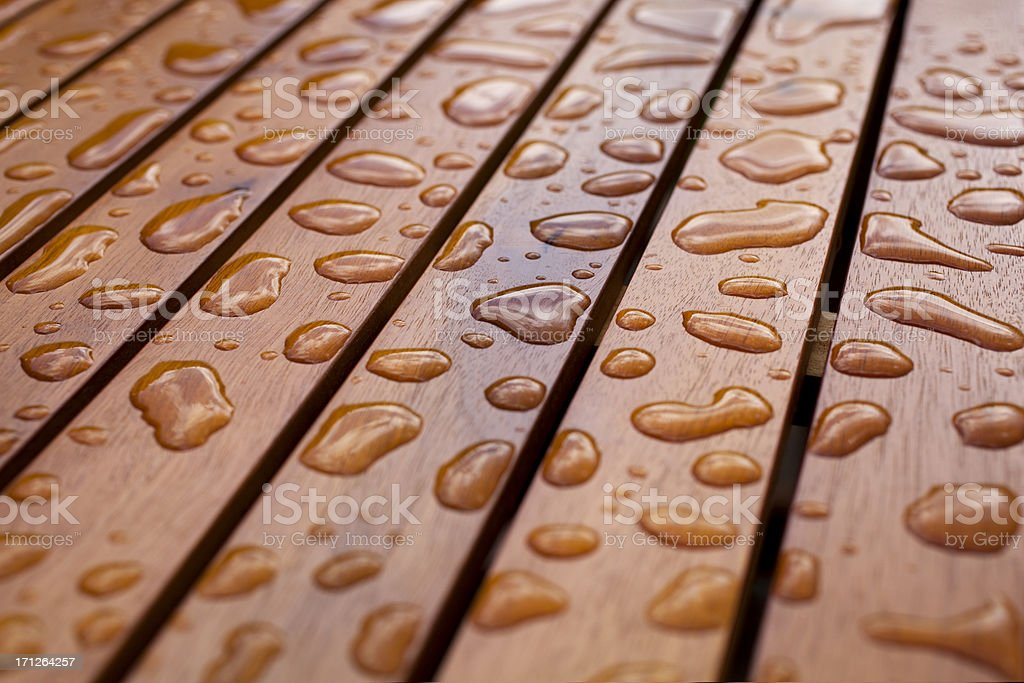 Water droplets on wood stock photo
