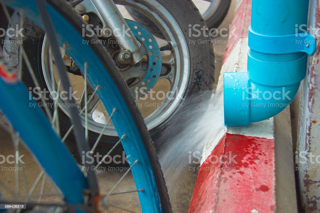 water dropping from plastic drain pipe, stock photo