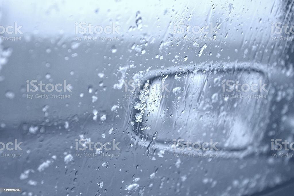 Water drops and snowflakes on a car window. royalty-free stock photo