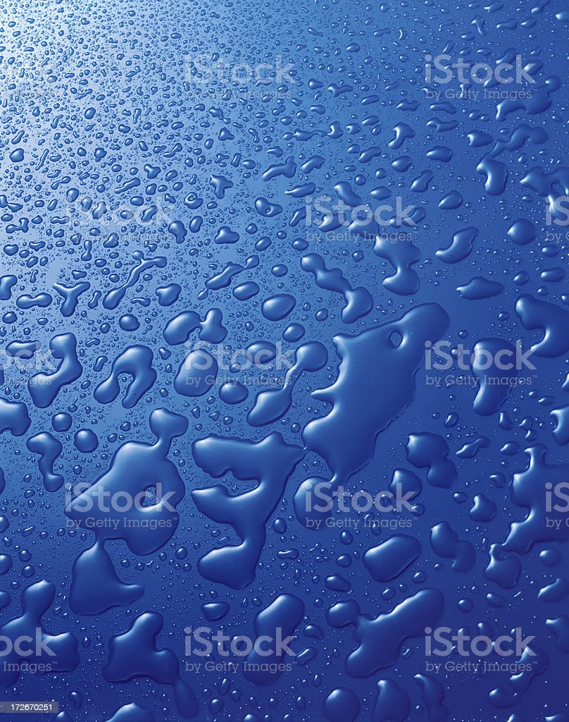 Water Drops background in blue royalty-free stock photo