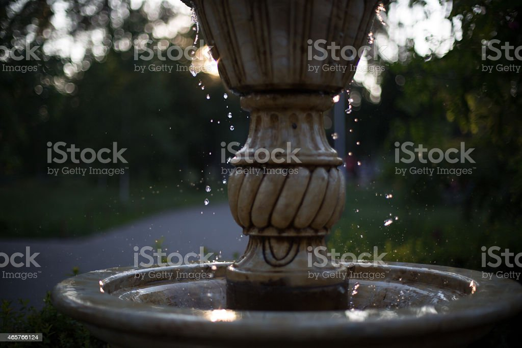 Water drops falling from the fountain stock photo