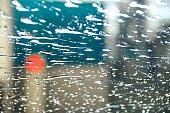 Water drops in washing car through glass