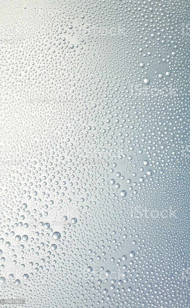 water drops on a glass surface stock photo