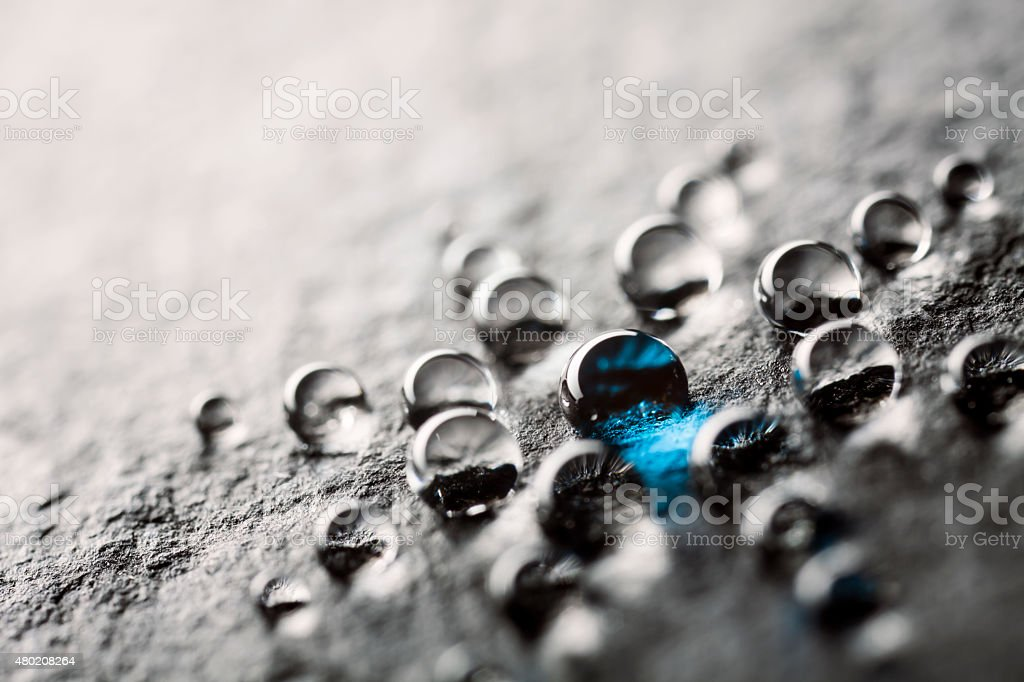 Water drops on black slate stock photo