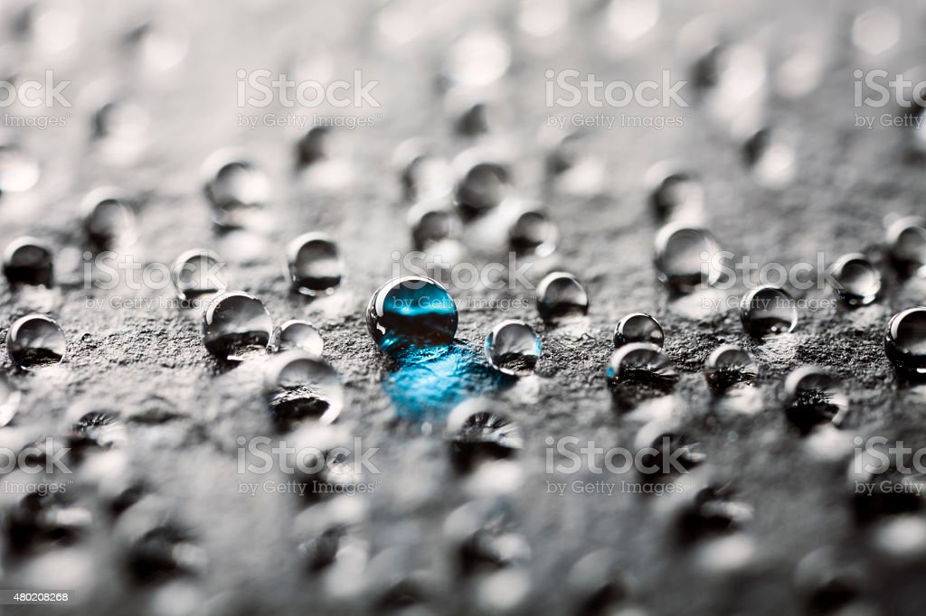 Water drops on black slate stock photo