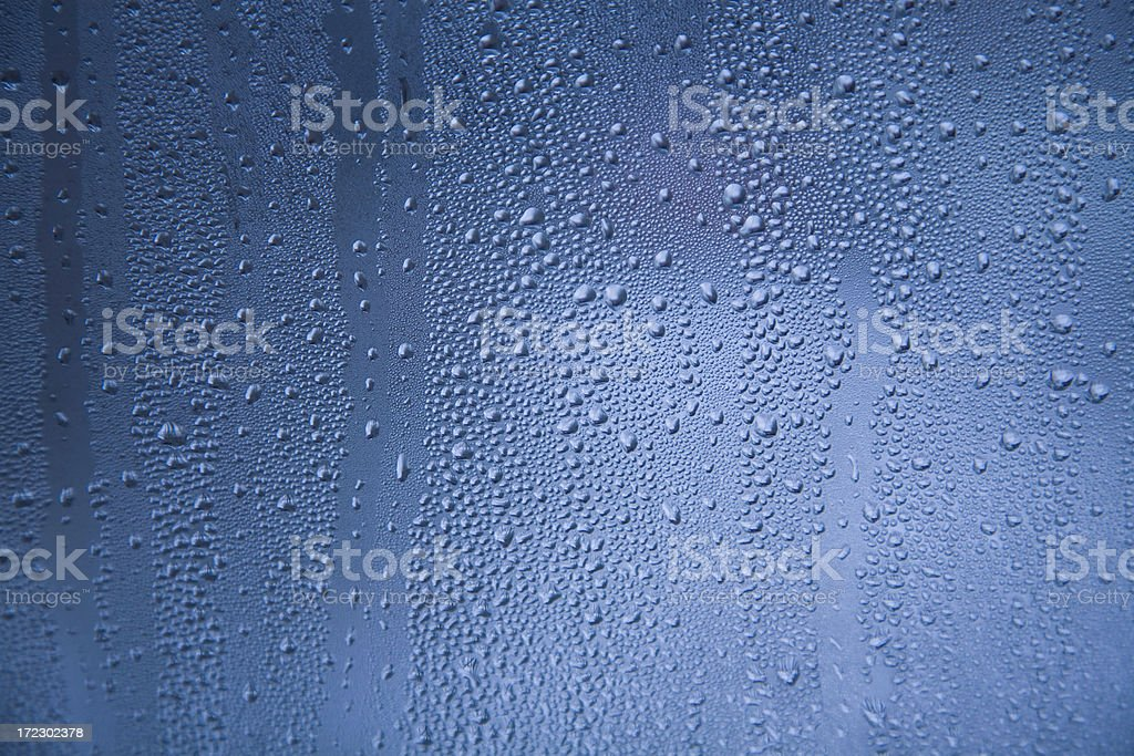water drops on blue glass royalty-free stock photo