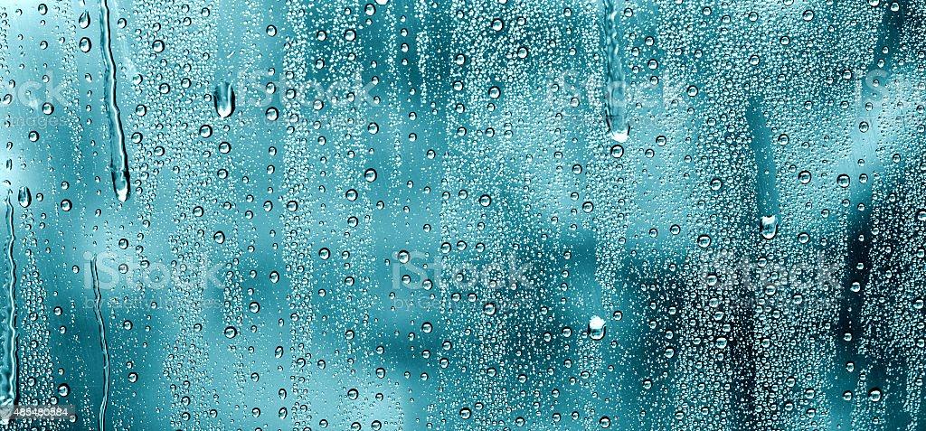Water drops on glass window stock photo