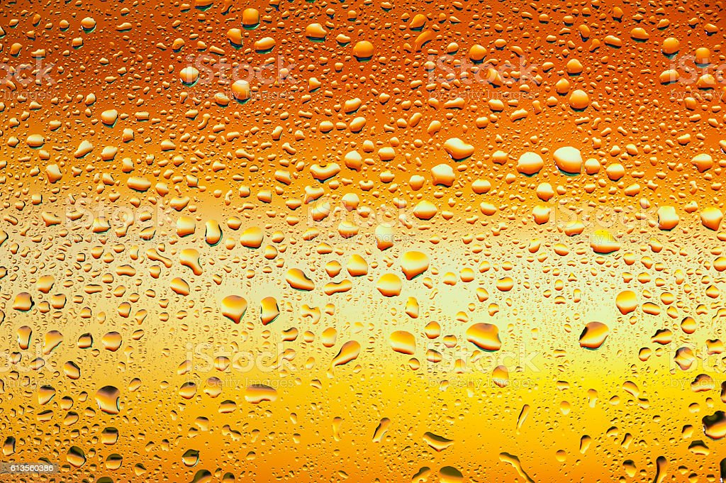 Water drops on glass with orange background stock photo