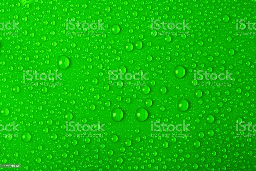 Water drops on green background stock photo