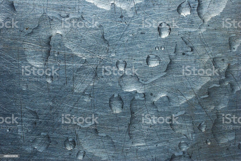 Water drops on silver metal background texture stock photo