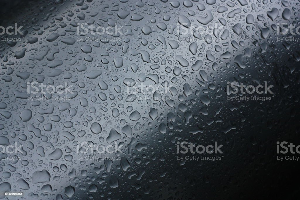 water drops on steel surface stock photo
