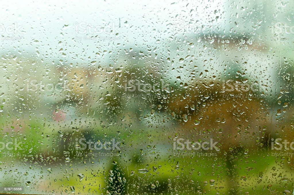 Water drops on wet window stock photo