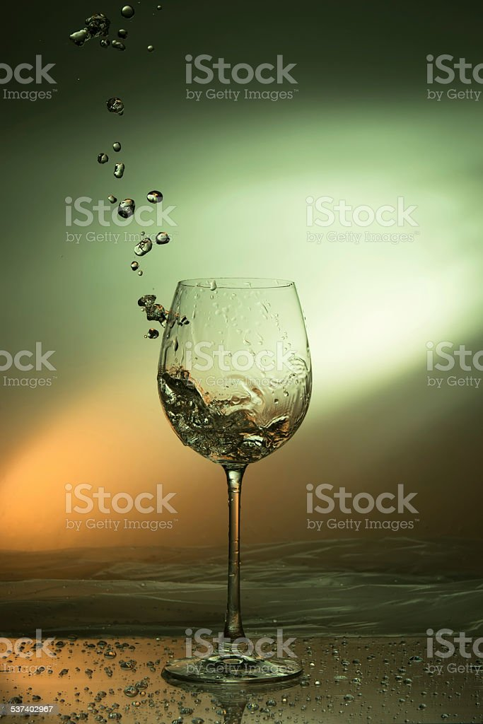water drops outside a drinking glass - splashing water stock photo