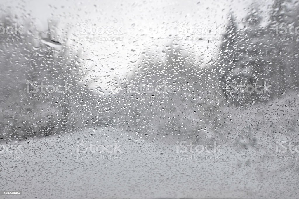 Water drops reflecting the winter landscape royalty-free stock photo