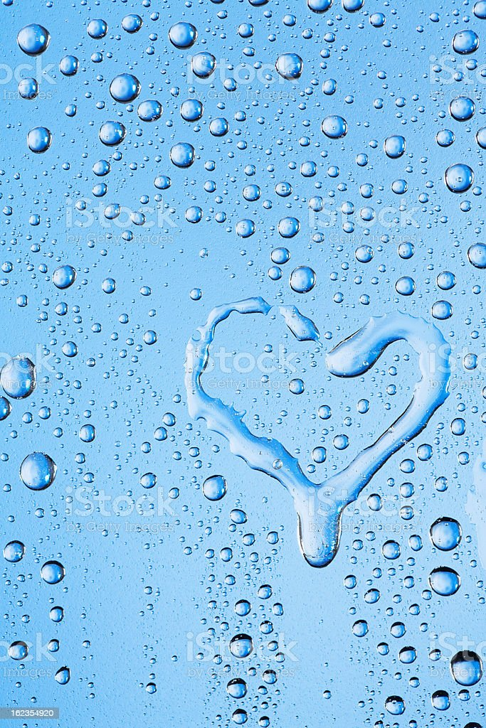 Water drops texture with heart shape stock photo
