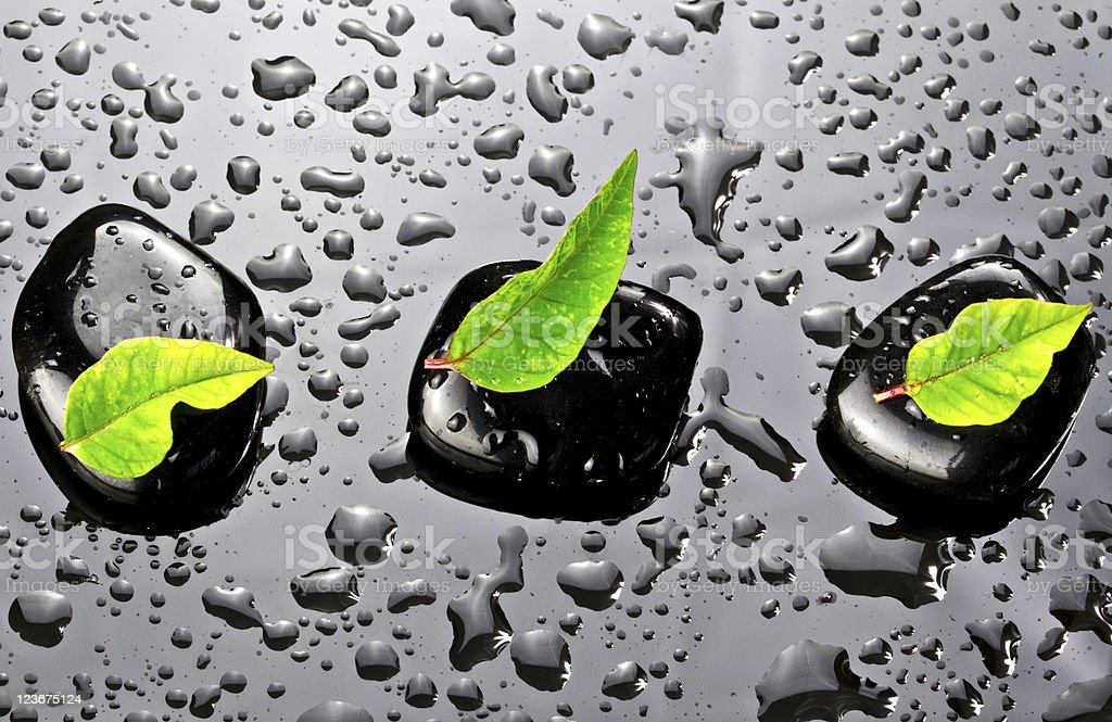 Water drops with spa stones royalty-free stock photo
