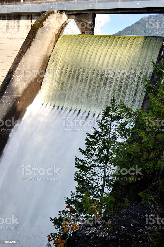 water falling down from the reservoir stock photo