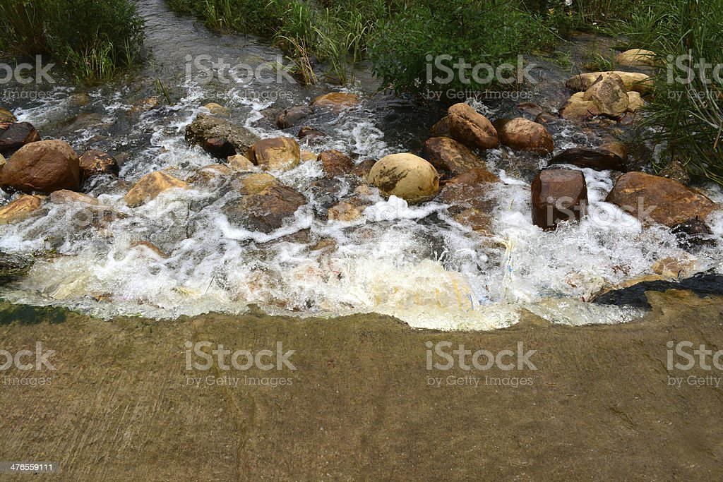 Water falling over a weir royalty-free stock photo