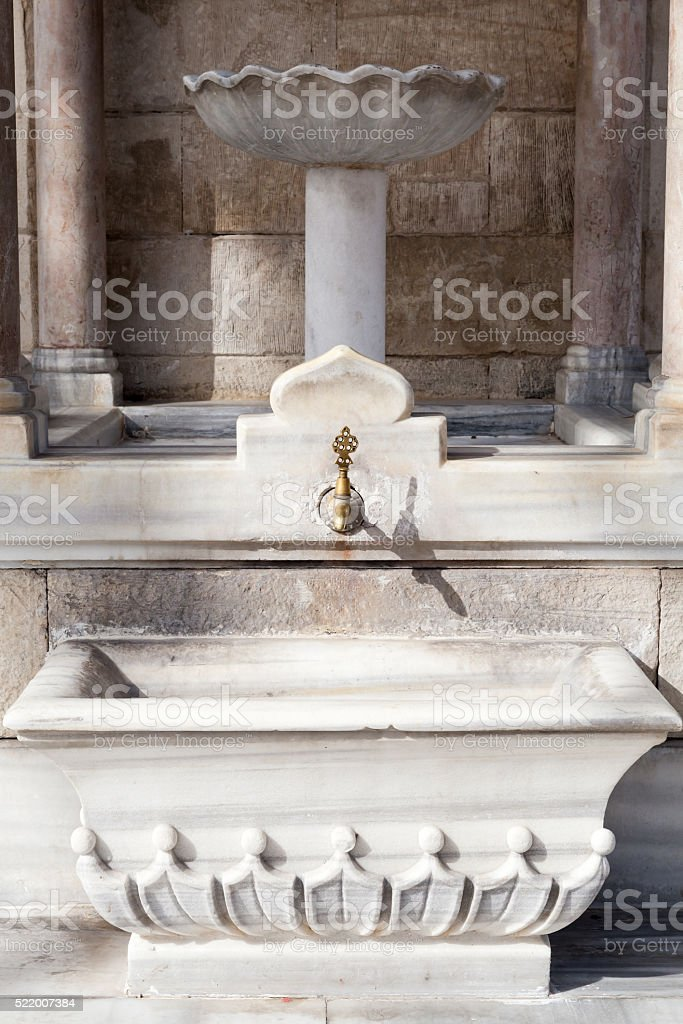Water faucet on historical clock tower in Izmir stock photo