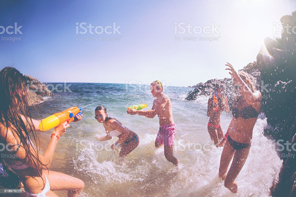 Water Fight at Beach stock photo