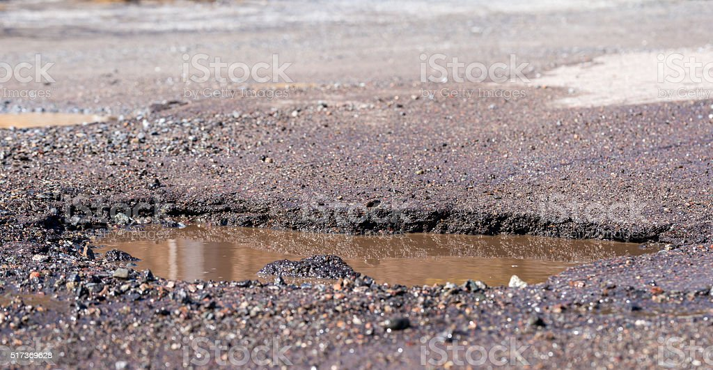 Water Filled Pothole stock photo