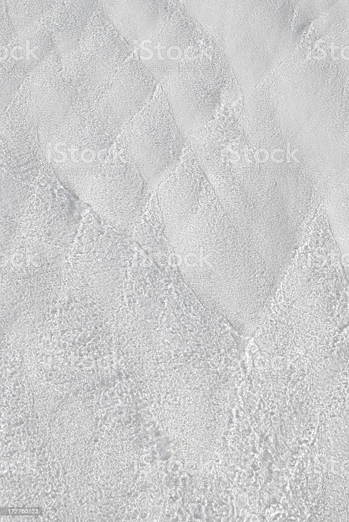 Water film flowing over calcium deposits royalty-free stock photo