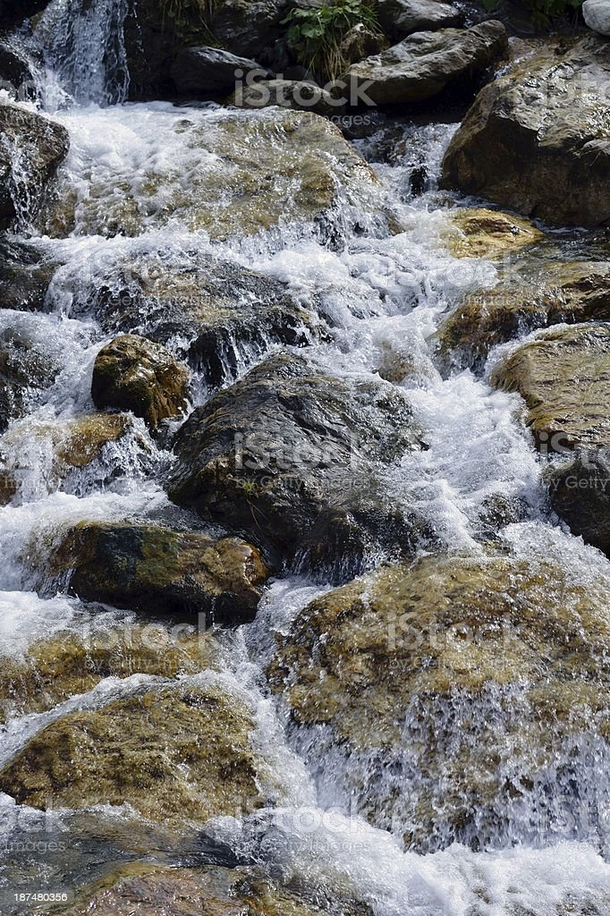 Water flooding over rocks stock photo