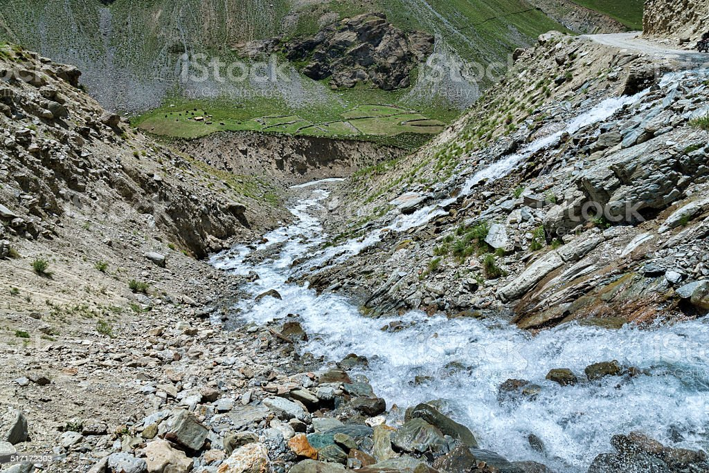 Water flow over mountain road stock photo