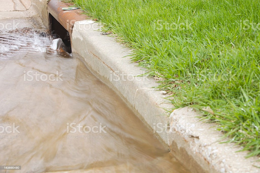Water Flowing Down a Storm Drain stock photo