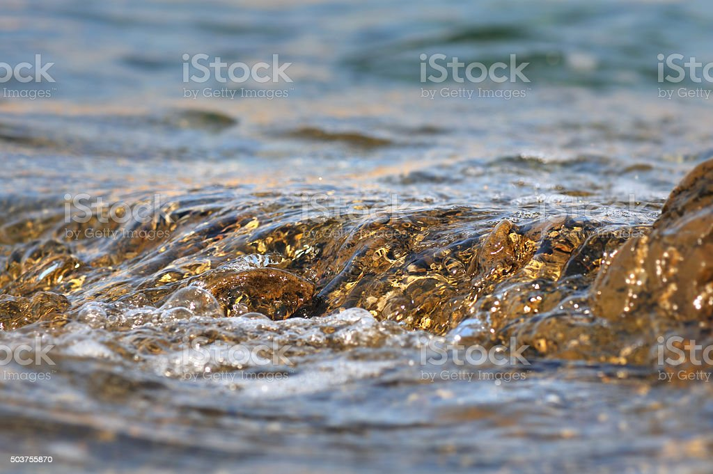 water flowing on a rock stock photo