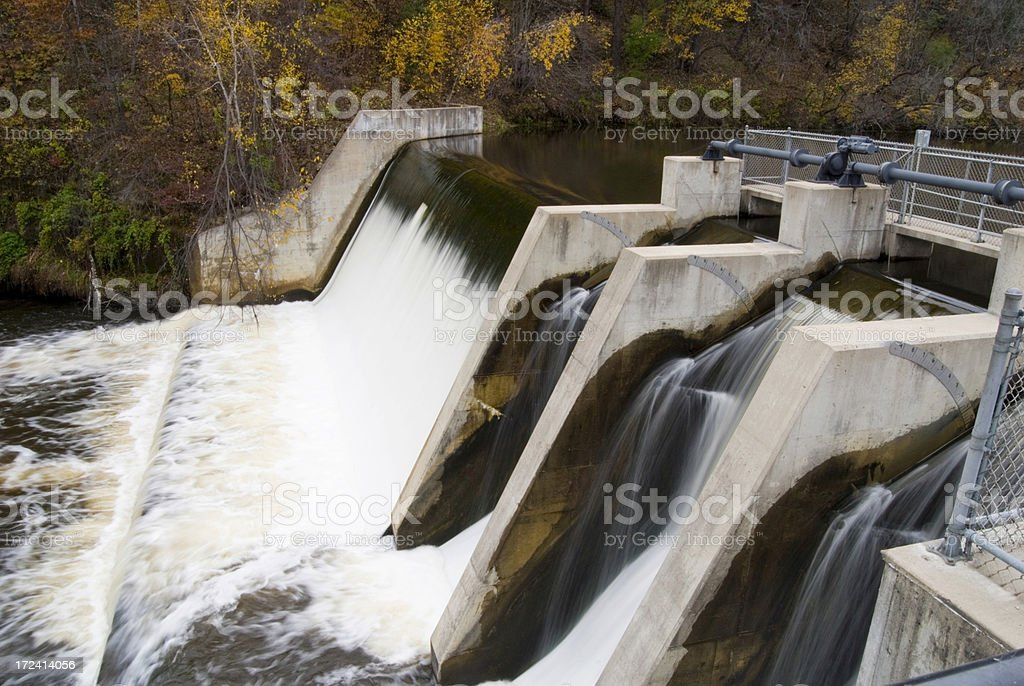 water flowing over a dam stock photo