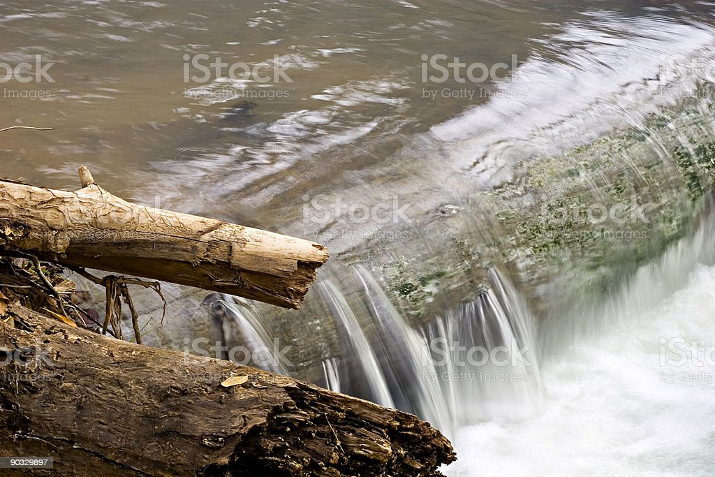 Water Flowing over a Log Jam. royalty-free stock photo