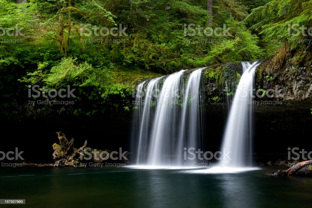 Water flowing over columnar basalt outcropping and cliff stock photo
