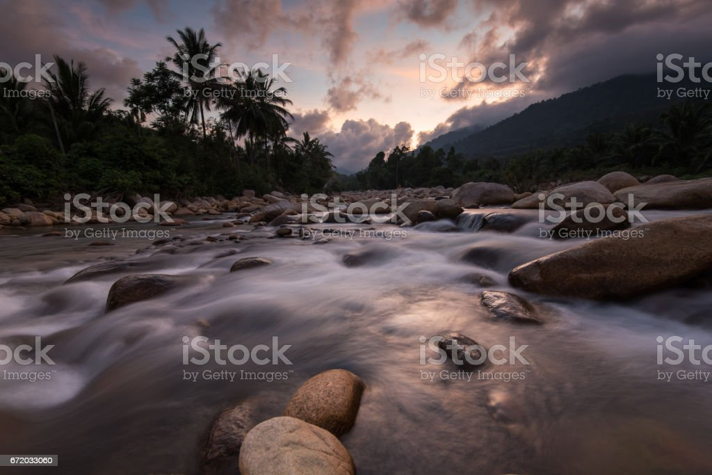 water flowing over rocks at the waterfall stock photo