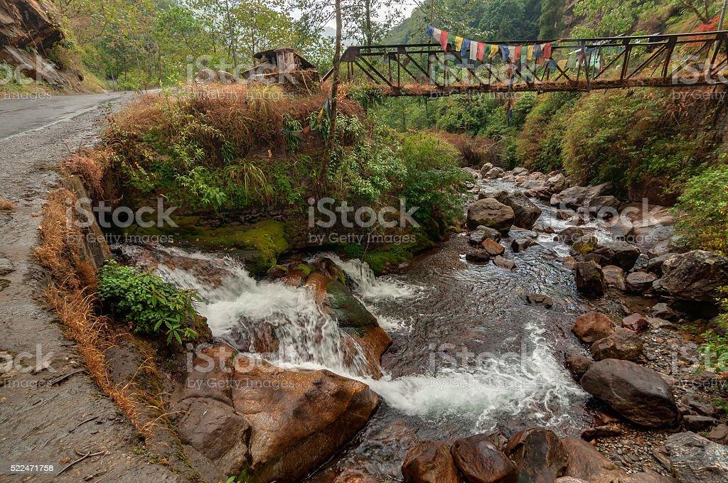 Water flowing through rocks, Kukhola falls, Sikkim stock photo