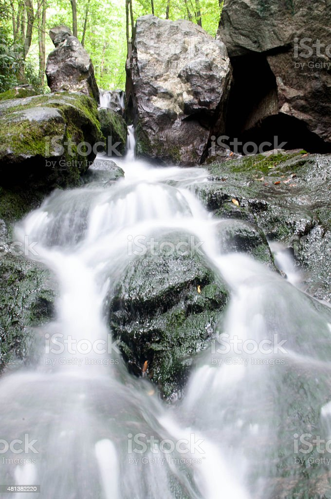 Water flows down the rocks stock photo