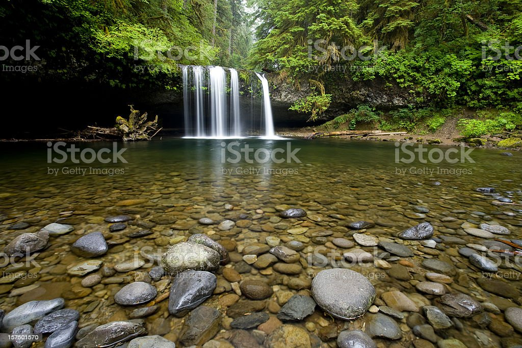 Water flows into pool from Upper Butte Creek Falls stock photo