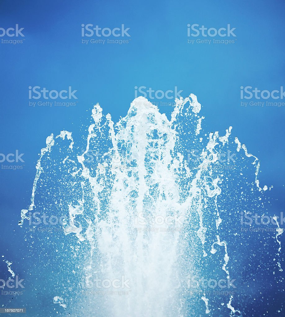 Water Fountain Against Blue Sky royalty-free stock photo