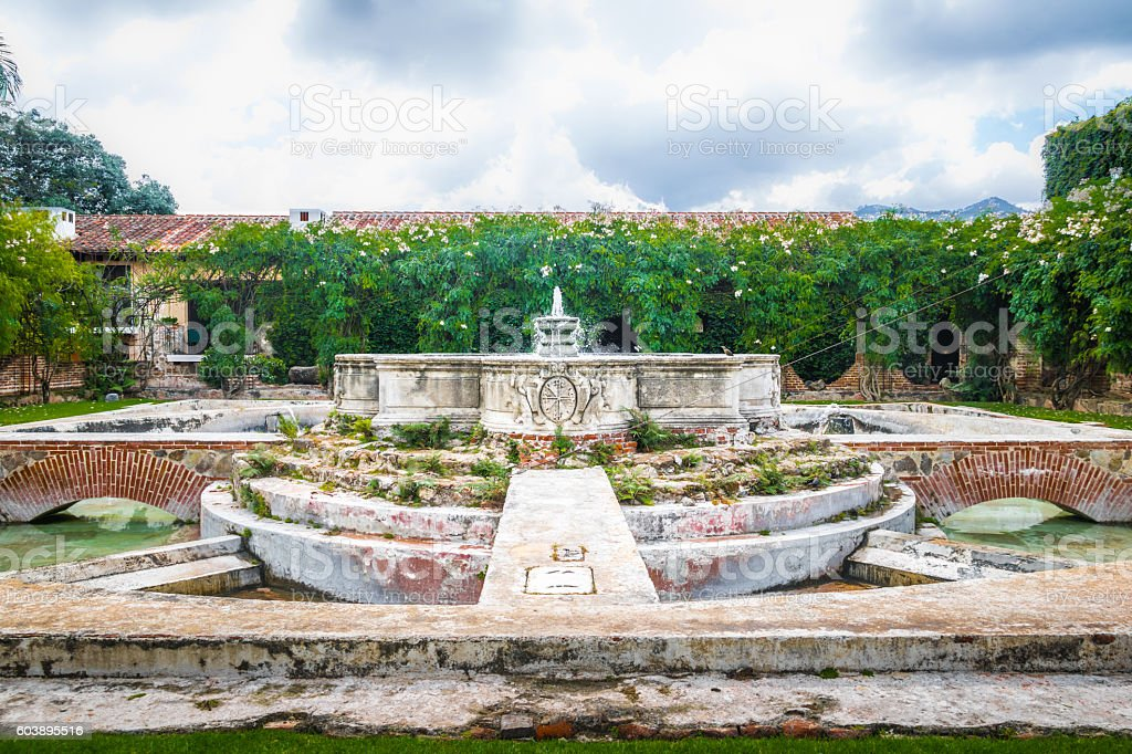 Water Fountain in ancient convent ruins - Antigua, Guatemala stock photo