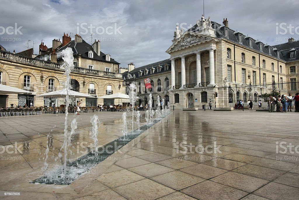 Water fountain surrounded by buildings at Dijon stock photo