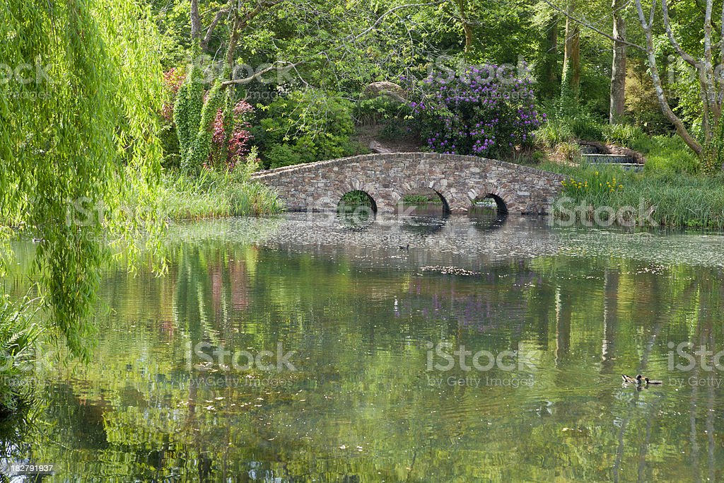 Water Garden and Stone Arch Bridge royalty-free stock photo