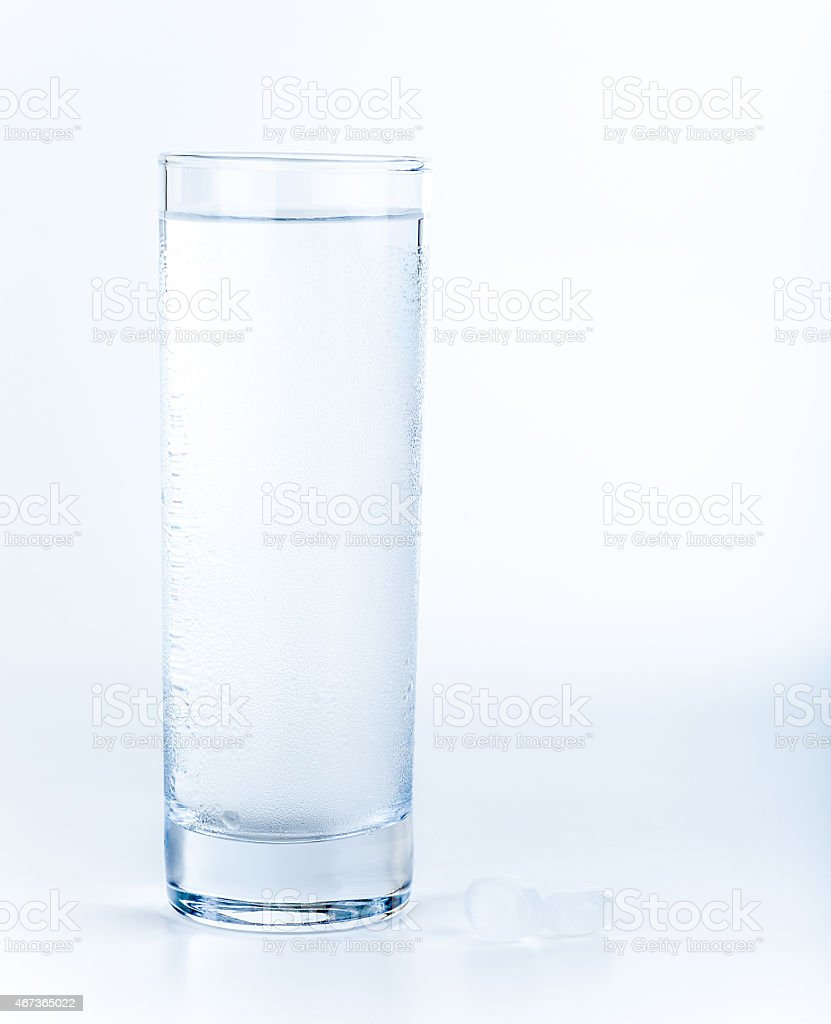 Water glass and pills prepared for their use stock photo