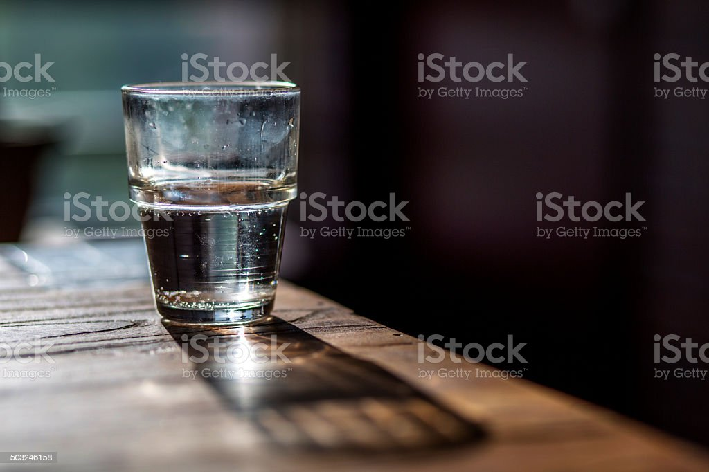 water glass on wooden table stock photo