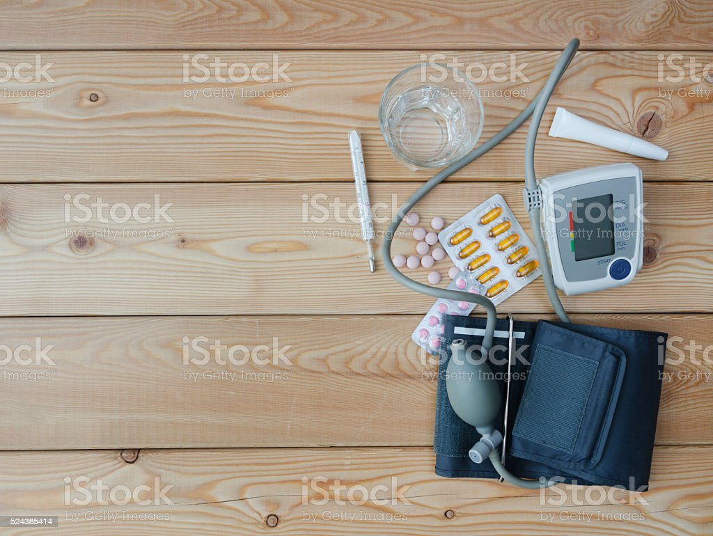 Water glass, tonometer, thermometer, and medicaments stock photo