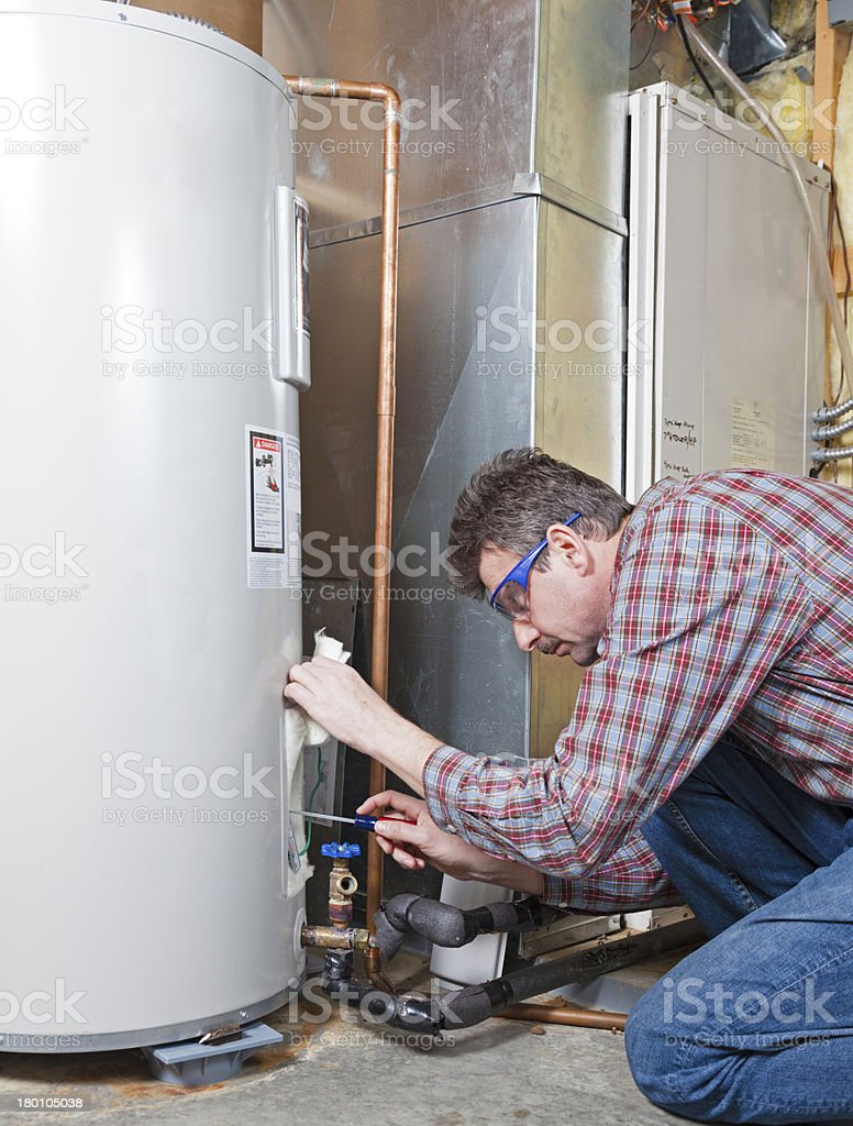 Water heater maintenance stock photo
